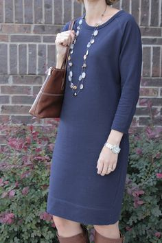 Fall Outfit Ideas: Navy and Brown. I scored this Navy Knit Shift Dress from Target off the clearance rack for $13. I paired it with my favorite riding boots and now have a great fall outfit. #RealMomStyle #OOTD #Fashion