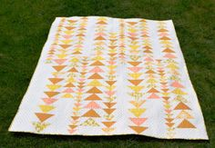 This sunny summer quilt pattern uses flying geese to make a beautiful quilt!