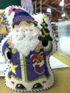 Po's Needlepoint in Charlotte, NC.  Love this Santa!