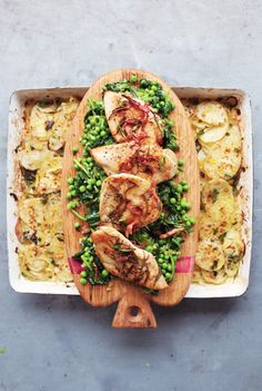 Jamie Oliver's golden chicken with braised greens and potato gratin