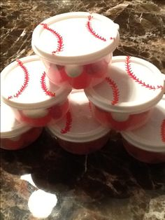 I bought those containers at the dollar store and paint those with the baseball stitches. Baseball party favors