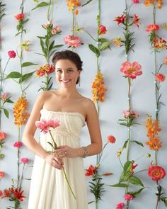 flowers as backdrop for photos. >> Lovely! My sister did this for my wedding and it was beautiful!