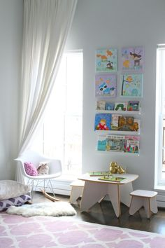 We love the idea of placing a mini table and chairs near the library wall! #nursery #kidsroom