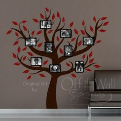 I am going to paint a tree on the wall and hang pics of the family to make a family tree!!  Love the ideas for large family trees!!
