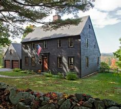 Colonial Saltbox Exterior Color Scheme: Dark grey, lighter toned wood, darker grey town trimming.