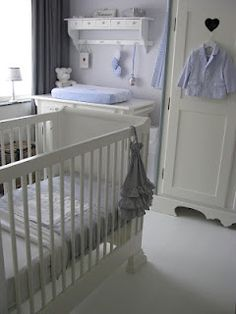 white and blue babyroom