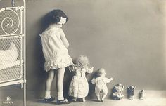 vintage postcard, little girl, with her dolls