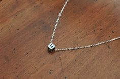 A great gift for her - a Silver Alpha Block Necklace.  A delicate and feminine necklace with a modern polygonal bead. A great stocking stuffer, Christmas gift, Valentine's Day gift or Mother's Day gift. Handmade and made in California by a maker and American artist. Support local artisans this holiday! https://www.aftcra.com/hayleym/listing/2967/silver-alpha-block-necklace