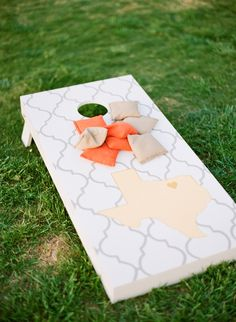 This cornhole design is so cute! Texas chic!   Photo by Taylor Lord Photography