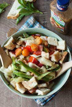 Skip the lettuce!  This easy panzanella salad is made of fresh zucchini ribbones, cherry tomatoes and zesty salaty dressing! www.lemonsforlulu.com #KraftSaladDressing #sponsored