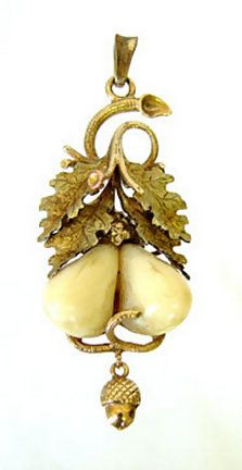 A fine intricate Victorian period Elk's teeth pendant with an acorn drop.