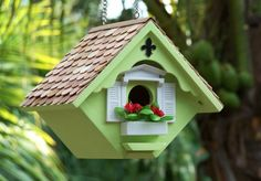 love the flowers on the bird house