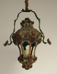 """18th century Venetian tole lantern with original painted finish. Swing arm may be of later date.  Dimensions: 29"""" high, 22"""" wide with hanging arm"""