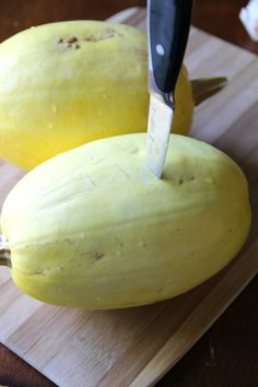 Cook spaghetti squash whole in a crock pot -- no more throwing knives across the kitchen to crack them open! :)