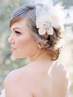feather and jeweled fascinator, photo by Melissa Brandman http://ruffledblog.com/highland-springs-resort-wedding #fascinators #weddingaccessories #hairaccessories