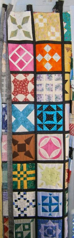 """Plum Quilts:  """"My long term WIP - a hybrid of hand and machine sewing - my Dear Jane quilt.  I'm only planning to do the squares on this project, but it is by far my longest running project.  Over eleven years so far."""""""