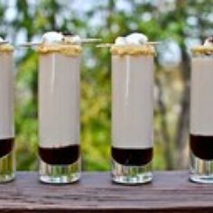 S'mores Shooters - Baileys, Marshmallow Vodka, and Godiva Chocolate Liquor. Yum!