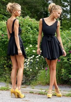 black dress and yellow pumps