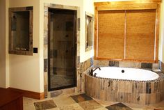 Master bath of the Cedar Ridge Plan 1125-D http://www.dongardner.com/plan_details.aspx?pid=3151 The #luxurious master #bathroom includes his-and-hers vanities, a soaking tub, and large walk-in #shower