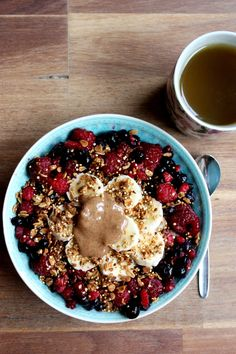 Vanilla oatmeal topped with raspberries, blueberries, banana, almond butter, honey and quinoa almond granola.