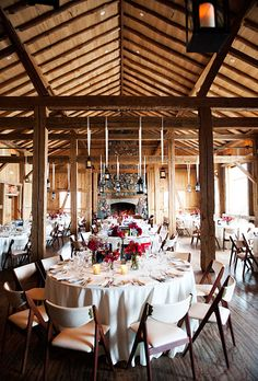 winter wedding inside a cozy barn, photo: Brinton Studios