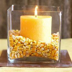 Creative Candle Idea    Nestle a candle into a vase filled with corn for a creative and quick fall centerpiece idea. Choose a theme and try other items such as jelly beans, buttons, or pennies.