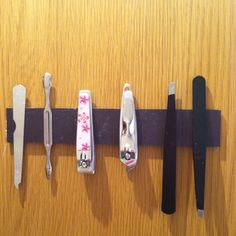 Magnet strip inside my bathroom cabinet, works like a charm!