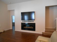 """This is a Majestic Echelon 600 linear direct vent gas fireplace in a remodeling project, recessed into a closet behind the wall. The """"picture frame"""" surround is black granite. gas fireplaces, picture frames, pictur frame"""