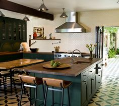 love this spanish-feeling kitchen with a beautiful tile floor