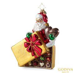 Our limited edition Christopher Radko® ornamen  featuring Santa enjoying a holiday favorite – a #GODIVA Holiday Ballotin.