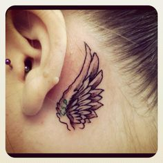 New tattoo I just got this morning ... Angel wing with my best friends initials in her fave color green ... She passed away from cancer last september ... R.I.P. <3