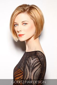This blunt cut bob is a red-hot trend for fall! The side part and honey-blonde hue lay the foundation for a sleek style with timeless appeal.
