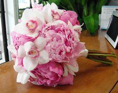 Cybidium and Pink Peony boquet! Peony is the flower that represents the 12th wedding Anniversary