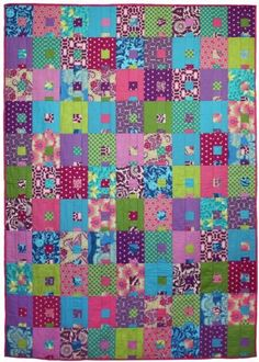 A beautiful quilt full of lush, saturated colour.