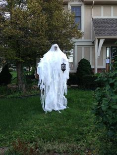 Halloween ghost for the front yard. Made of PVC pipes, a foam skull head, fabric and an old lantern decoration.
