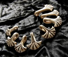 Faux bone is really turning me on these days. palmate pendants  group 2 by SelenaAnne, via Flickr