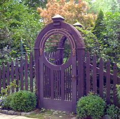 purple gate with copper accents.