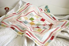 Love the way Amy uses low volume prints as whites, both in quilts and embroidery.