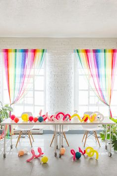 DIY Rainbow Streamer Curtains to make your party a little brighter!   #diy #craft #handmade