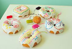 Homemade glazed doughnuts with sprinkles as stitches.