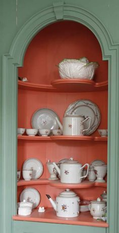 This corner cupboard uses complimentary shades to make a statement. See more of this house in our upcoming October 2013 issue. #color #earlyamericanlife