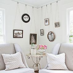 hooks in picture rail moulding. Hang photos most of the year, change out for xmas wreaths or decorations for seasonal impact.