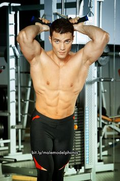 Male fitness model at the gym.