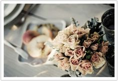 A gathering of muted pale pink roses are perfect to create a vintage tablescape.  Design by Alchemy Fine Events   www.alchemyfineevents.com