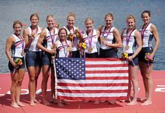 Members of the United States team celebrate with their gold medals and the national flag during the medal ceremony.