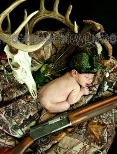 Babies REALLY should't be surrounded by carcasses and firearms
