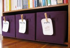 Cardstock and Clothespins to label bins.