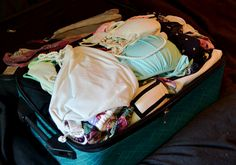 How to pack for the honeymoon -- blog post has a link to a slideshow that's pretty neat.  I think I'll try this method -- seems like I can get more stuff in there.