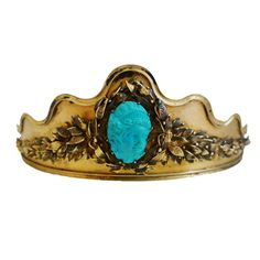 Persian Turquoise Tiara from France, circa 1890. This is a beautiful antique tiara in with scrolled leaf details and a carved cameo in Persian turquoise. Ends are made for a ribbon attachment. A gorgeous collectors piece with a beautiful patina!