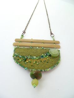 Fragments in green X mixed media necklace by Cesart64 on Etsy